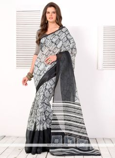 Designed with simplicity with a touch of soberness in its work makes a masterpiece. Be the sunshine of everyone's eyes dressed in this beautiful black and grey art silk casual saree. The print work ...