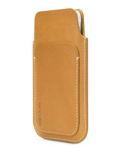 Constructed of premium full grain leather, the Leather Pouch protects your iPhone and carries an essential card or two. Soft suede interior lining keeps your iPhone safe from scratches, while reinforc