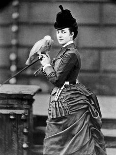 A 28 year old Alexandra, Princess of Wales, photographed in London with her pet parrot | Jan. 1872