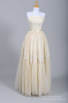 Wedding Dress, Emma Domb: 1950's, alencon style lace on net over an acetate lining in the bodice, tulle with appliqués over two additional layers of tulle to add fullness.