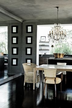 Stunning Modern Dining Room with dark rich colors for the walls, floors & console. The contrast makes the dining chairs & table stand out. Chandalier adds the sparkle!