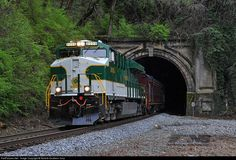 """""""Southern"""" 8099 exits the tunnel portal at """"North Tunnel"""", underneath Chattanooga's Lookout Mountain. The heritage ES44AC led today's """"21st Century Steam"""" excursion from the Tennessee Valley Railroad Museum in Chattanooga to Attalla, Alabama, and back."""