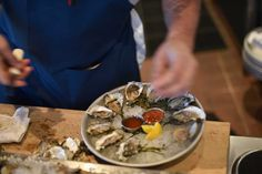 Oysters are prepared and plated