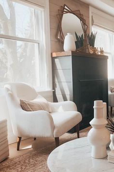 A curved back and slightly winged arms give this chair a whimsical feel, while the cool tone and solid wood legs keep it firmly grounded. A wide seat makes the Embrace arm chair the perfect spot to cuddle a dog, sip coffee, or accidentally fall asleep. Photo by Brianne Penney. #LoungeChair #HomeDecor #HomeDesign