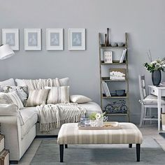 35 Stylish Neutral Living Room Designs = The placement of coffee table and book case visually extend the LR area.