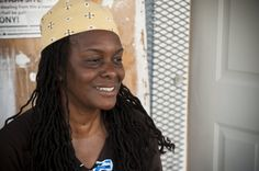 Women Build volunteer devoting her time to help in the effort to eliminate poverty housing.