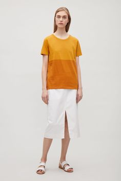 This simple round-neck t-shirt is cut from pima cotton with an extra-soft feel. A straight fit, it has a ribbed round neckline, short sleeves and neat topstitched edges.