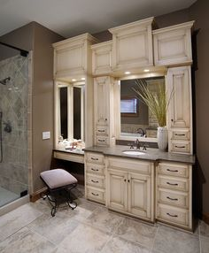 Bathroom vanity with built-in cabinets around mirrors