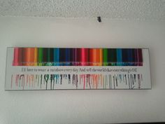 """I melted crayons in order of the rainbow and added a Johnny Cash quote from """"Man in Black"""". I used 2″ painters tape, melted the crayons and while it was still a little soft I pulled it up."""