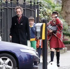 Amicable exes: Helena Bonham Carter and Tim Burton reunited on Sunday in London with their...