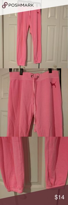 Hot pink VS PINK sweatpants Hot pink sweatpants with VS PINK dog on front and black letters on back. Really comfy ankle length joggers with bands at the ankle PINK Victoria's Secret Pants Track Pants & Joggers