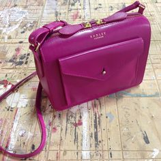The Keats Grove small leather zip-top grab bag is a new style for this season, and pops in bright pink!