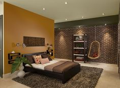 Benjamin Moore Paint Colors - Orange Bedroom Ideas - Sophisticated Orange Bedroom - Paint Color Schemes . . . . . This true shade of orange exudes seasonal cheer. . . . . . Accent Wall (by bed headboard) - Autumn Orange (2156-10); Soffit (above brick wall) - Durango (2137-30); Ceiling - Monroe Bisque (HC-26).