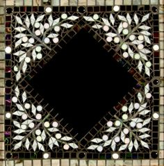 Black Winter Leaves Mosaic Mirror with an offset mirror placement