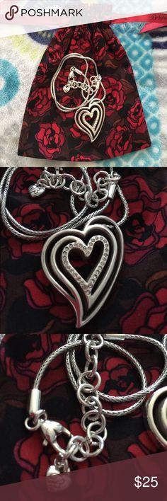 Authentic Brighton Silver Heart Necklace Authentic Brighton silver heart necklace.  EUC.  No scratches.  Comes with Brighton red and black rose dust bag/pouch.  🚫Trades.  Thanks for looking! Brighton Jewelry Necklaces