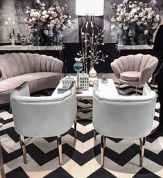Millennial pink in all black and white living room giving it a feminine look I Décor Aid
