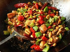 As much as I now love real-deal Sichuan kung-pao chicken, my absolute favorite Chinese dish as a kid was this mildly spiced Americanized version—and to be honest, I still love it today. Just because it's a Chinese-American standard, complete with slightly-gloppy-sauce and mild heat doesn't make diced chicken with peppers and peanuts any less delicious. Here's how to make it at home.
