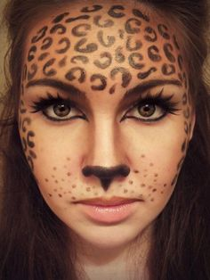 Leopard makeup for Halloween @Monica Forghani Forghani Forghani Gonzales this could be your costume dress in black and paint your face like this!!!!