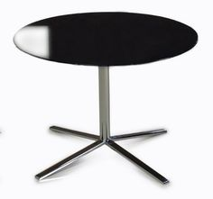 """Versus T48A - Black End Table. The T48 Black End Table exhibits dramatic simplicity featuring a polished black top with svelte stainless steel base and tong-like legs. This gorgeous end table measures Dia.23.5""""x14"""". Dimensions  Ø23.5""""x14""""  Color:  Other Finish:   Product ID(s):  12200"""
