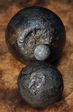 """Musket and cannon balls Salvaged from Blackbeard the Pirate's ship, the """"Queen Anne's Revenge"""" by Forrest Seas."""