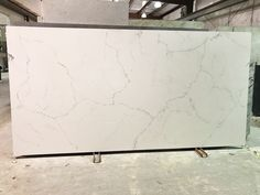 """Montclair"" by Alleanza Quartz is one of our most popular & realistic looking engineered quartz colors that imitates the appearance of white marble. Stop in to Stoneshop's showroom in Cherry Hill, NJ to view the slabs in person!"