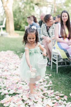 Adorable flower girl in teal: http://www.stylemepretty.com/canada-weddings/quebec/montreal/2016/07/20/when-a-wedding-photographer-gets-married-its-all-about-the-details/   Photography: Richelle Hunter Photography - http://www.richellehunter.com/