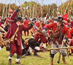 Musket vs. sword: Sealed Knot members duel at a re-enactment of the Siege of Basing House, an event in the English Civil War, 1642. GB
