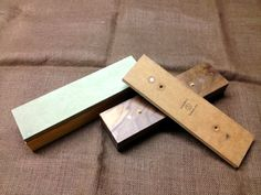 If you sharpen with sandpaper this convenient sharpening system is easy to build. Leather strop, glass tops for sandpaper, all attached with magnets and a 3/4 hole for brass bench dogs to keep the blocks securely on your bench.