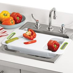 """Prep like a pro! A great space-saving solution—chop and drain all at once! Expandable to fit most kitchen sinks. 24 1/2"""" L (when fully expanded) x 9 1/2"""" W x 2 1/4"""" D. Dishwasher safe. Plastic. Imported.  www.youravon.com/lonie"""