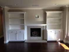 built-in shelves around fireplace | Built in cabinets around fireplace | New HOUSE