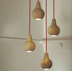 """""""Cape Town designers Animal Farm are launching a wooden light fitting at the Design Indaba Expo in Cape Town, South Africa this weekend.    Lite is manufactured in several different species of wood and is designed so that it can only be used with an energy saving light bulb."""""""