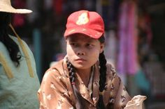 Picture of Burmese girl with tanakha on the market of Pathein ...