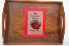 13 1/2 x 10 1/4 x 3/4  serving tray with cross stitch pattern underneath a high shine resin