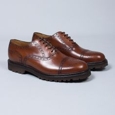 Berwick  Men's Tobacco Lace-Up Brogues: This pair of tobacco lace up brogues from Berwick are luxury personified. Berwick use premium leather from the German tannery of Jon Rendenbach Jr, where the cuts are tanned for an entire year in oak leaves. The design is finally coloured and patterned by hand, giving every pair a unique finish.