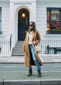 aimee song wearing neutral layers in Notting Hill