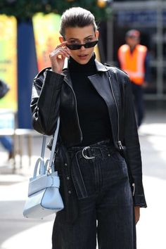 Black outfit with contrasting bag