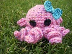 $6.00    Miss Olivia is a soft, plump mini octopus, accessorized with a pretty blue bow. She has 8 curly tentacles. She is made with a snowflake wool blend yarn. She's the perfect toy for a new baby or your ocean-loving little girl.