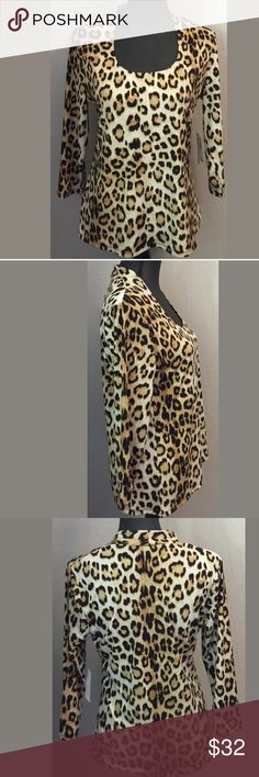 """Grace large 3/4 sleeve top animal print New with Tags Grace large 3/4 sleeve top, animal print. Polyester/Spandex. Bust 19"""" armpit to armpit. Length 24 1/4"""" shoulder to hem. Sleeve 18"""" Measurements are approximate. MSRP $68 Grace Tops Blouses"""