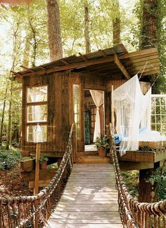 This micro cabin in the woods, was built and designed by Peter Bahouth. This tree house uses a good deal of recycled materials, including 100-year-old windows taken from a Masonic Temple. The structures are also built so as to inflict minimal harm and damage to the trees that support them (always a great idea).