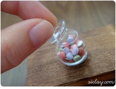 OMG!  A miniature glass jar of macarons!