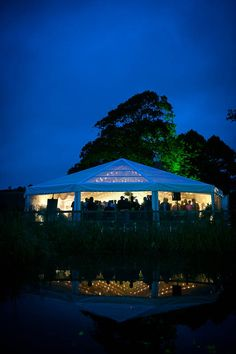 Clear roof bell shaped end to frame marquee by night!