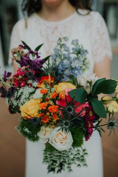 Love the bright colors in this bridal bouquet | Bright Wildflower Bouquet (made by the bride's mom!) | Emporium Center Wedding | Downtown Knoxville Wedding | Kellie GO Photo | Absolute Wedding Perfection