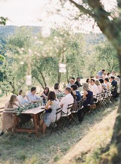 Dinner in a Tuscan olive grove, candles hanging in every tree | Rylee Hitchner Photography