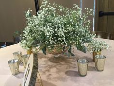 Baby's Breath Centerpiece in Mercury pedestal Bowl With Mercury Glass Votive Candles