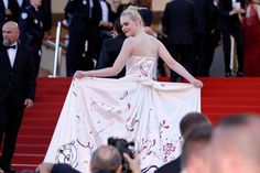 """Elle Fanning attends the """"Ismael's Ghosts (Les Fantomes d'Ismael)"""" screening and Opening Gala during the 70th annual Cannes Film Festival at Palais des Festivals on May 17, 2017 in Cannes, France."""