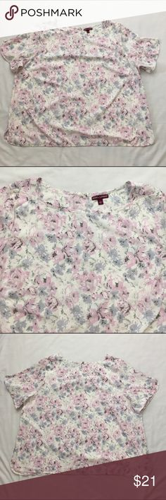 """Jessica London Floral Pastel Blouse, Plus size 28 Jessica London floral blouse, boat neckline, split hem.  Color is white mixed with blue and lilac.  Fabric 100% polyester. Machine washable.  Size 28 Armpit to armpit 29 Length 31"""" Approximate only.  Pre-owned in great condition.  Stored in a smoke and pet free household.  Please see pictures for details or asks any questions before buying to avoid return! Jessica London Tops Blouses"""