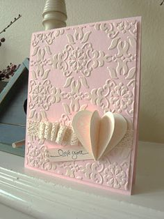 Very girly card with a nice use of inking on the embossed pattern - penguinstamper