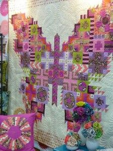 tulapink - Sampler quilt idea--Tula Pink had this at the SEW-Expo-Puyallup, it was awesome to say the least!  She is totally a quilters dream - always inspiring us for more, use those favorite fabrics ladies and move on!!
