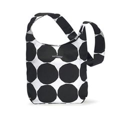 Spruce up any outfit with the Marimekko Kvartsi bag; it is the perfect complement to any outfit, formal or informal. The repeated circle pattern lines the outer surface and the inner lining has a zippe