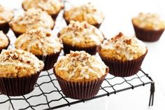 Banana, carrot and pecan muffins with orange icing
